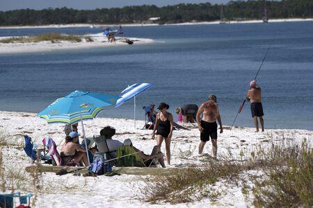 Santa Rosa Island Pensacola Florida USA - October 2016 - Holidaymakers on the beach Editorial
