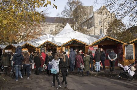 winchester: Visitirs to first weekend of the annual Christmas Market at Winchester Cathedral Hampshire England UK 17 December 2016 Editorial
