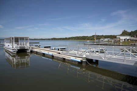 landing stage: Lake Dora Florida USA - October 2106 - Landing stage for boats on the waterfront of Lake Dora