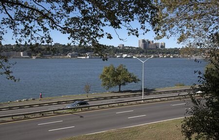 hudson: Hudson River New York USA - October 2016 - The Henry Hudson Parkway looking over the Hudson River to New jersey NYC