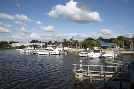 alongside: Tarpon Springs Florida USA - October 2016 - An overview of pleasure cruisers docked at Tarpon Bayou Fl US