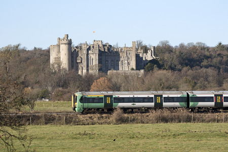 rolling landscapes: Passenger train passing a historic castle England UK November 2016 - A southern railways passenger train passing Arundel Castle in West Sussex southern England UK