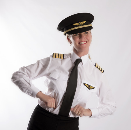 Woman pilot in uniform acting out the concept of flying - September 2016
