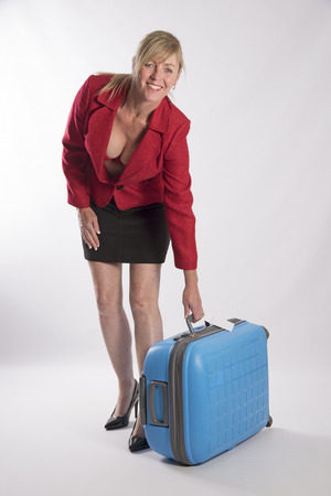 Woman lifting a blue suitcase