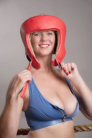 female boxer: Female boxer wearing a safety head guard