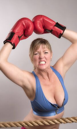 gritting: Angry female boxer gritting her teeth Stock Photo