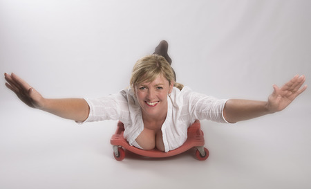 Woman wearing white open shirt in a concept of flying