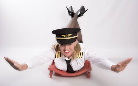 Airline officer laying on a trolley in a concept of flying