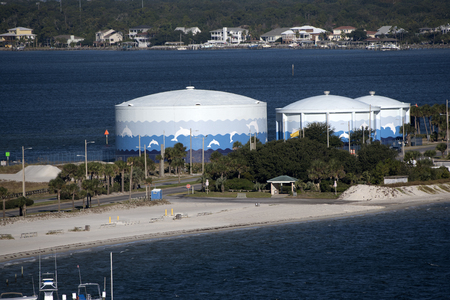 Water storage tanks painted with leaping dolphins Pensacola Beach Florida USA