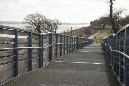 cycleway: Cycleway and pedestrian foothpath acrooss rail lines to the Exe Estuary footpath near Starcross in South devon England UK Stock Photo