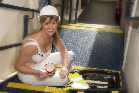 Attractive worker taking a tea break in her place of work Stock Photo