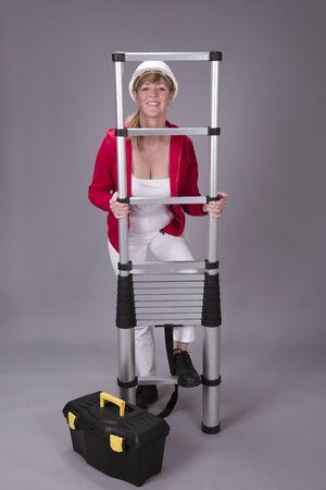 telescopic: Woman holding a telescopic ladder