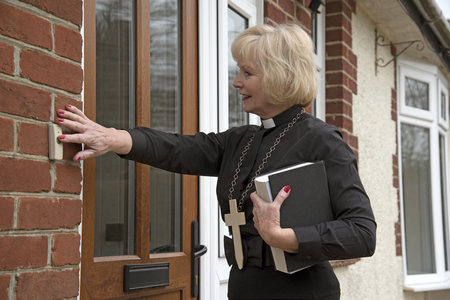 vicar: Elderly woman vicar making a house call Stock Photo