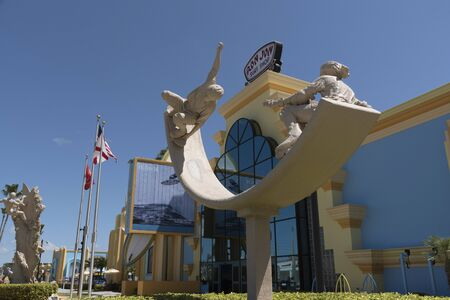 Sand sculptures and Ron Jons famous surf shop on Coacoa Beach Florida USA Editorial