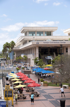 Tampa Convention Center tables with umbrellas on the waterfront in Tampa Florida USA. April 2017
