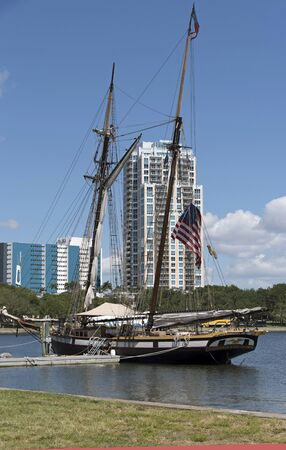 The North Yacht Basin in St Petersburg Florida USA. April 2017. The privateer schooner Lynx a replica historic American man o war at anchor. The tall ship is registered as an educational organization.