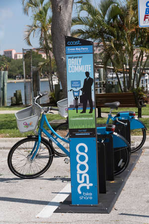 apri: Cycles to rent from a stand on the waterfront in St Petersburg Florida USA. Apri; 2017 Editorial