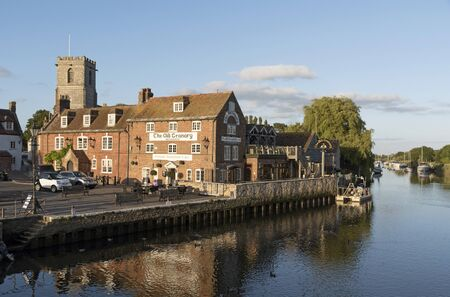 premises: The River Frome at Wareham a small Dorset England town. June 2017. Phot taken during the low light of the evening. Editorial