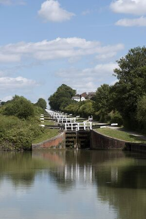The Caen Hill Lock Flight on the Kennet & Avon Canal in Devizes Wiltshire England UK