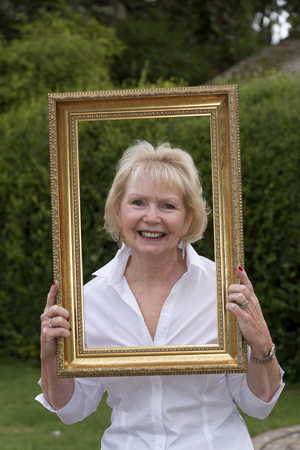 oap: Portrait of an elderly lady in a gold picture frame