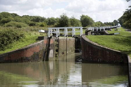The lower lock with gates open of the Caen Flight of Locks on the Kennet & Avon Canal at Devizes Wiltshire England UK