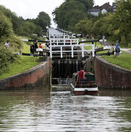 Narrowboat entering the lower lock of the Caen Flight of Locks on the Kennet & Avon Canal in Devizes Wiltshire UK