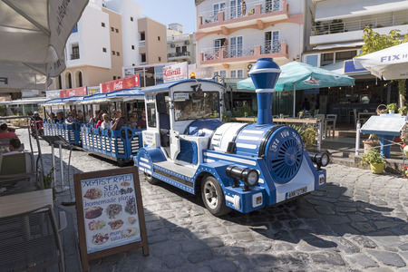 Agios Nikolaos, Crete, Greece. A tourist fun train taking visitors on a tour of the town. October 2017 Editorial