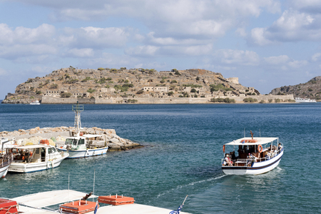 The Spinalonga Island ferry departing Plaka with passengers to the famous leper island, Crete, Greece. October 2017 Editorial