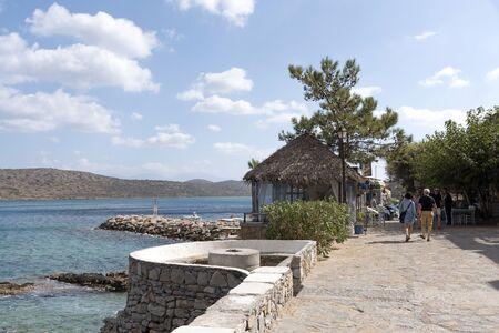 Seafront walkway at the seaside resort of Plaka, Lasithi, Crete, Greece. October 2017 Editorial