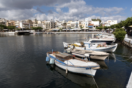 Agios Nikolaos, Crete, Greece. small fishing boats on the Lake which is said to be bottomless. October 2017