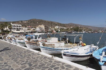 The fishing boat harbour at Elounda a seaside resort in northern Crete, Greece. October 2017 Editorial