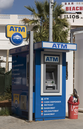 Malia, Lasithi, Crete, Greece, October 2017.  ATM machine on a street in Malia a seaside resort