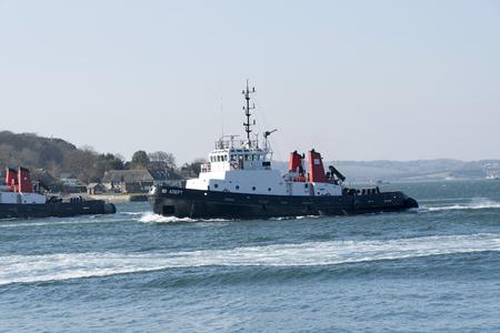 Plymouth, Devon, England, UK. Ocean going tug  SD Adept underway departing Devonport Harbour. February 2018 Editorial