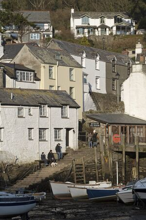 Polperro harbour, Cornwall, England, UK. February 2018. Low tide during winter in this famous little harbour. Editorial
