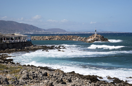 Sisi, Crete, Greece. 2017. Seafront resaurant  on the harbour entrance from the Sea of Crete