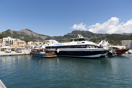 Port de Soller, Mallorca, Balearic Island, Spain. 2018. Excursion boats line the harbour at Port de Soller a popular holiday resort in Mallorca.
