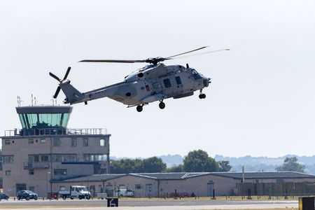 Marine helecopter passing a control tower on an airfield Banco de Imagens