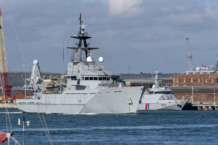 HMS Tyne departing Portsmouth Harbour on Sunday afternoon to patrol the offshore fishing areas of the English Channel. Passing French fisheries patrol ship Flamant. Sunday 16 September 2018. Picture: Peter Titmuss/ Alamy Live News.
