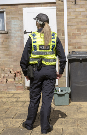 Portrait of a policewoman in uniform standing at a crime scene Stock Photo