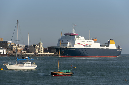 Commodore Goodwill a cross channel commercial ship entering Portsmouth Harbour, England UK.