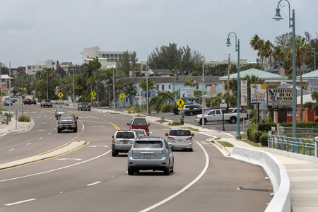 St Johns Pass, Florida, USA. Circa 2018. Traffic heading south  along the Gulf Blvd and its many motels and hotels Redactioneel
