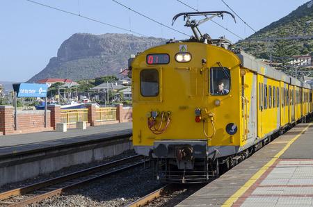 Kalk Bay, Cape Town, South Africa. Circa 2017. A yellow metro passenger train at Kalk Bay station Editorial