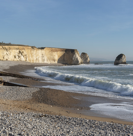 Freshwater Bay, Isle of Wight, England, UK. Incoming tide on a winters afternoon on the Isle of Wight