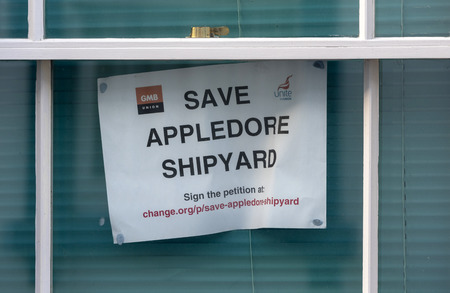 Appledore, North Devon, England, UK. February 2019. Poster on display in a house window supporting a campaign to save Appledore Shipyard which is due to close down in March with a loss of jobs Editorial