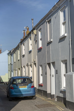 Appledore, North devon, England, UK. February 2019. Car driving through very narrow street of terraced homes in this popular seaside Devonshire town in winter