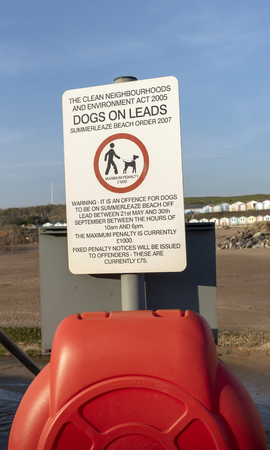 Bude, Cornwall, England, UK. March 2019. Official notice regarding rule for keeping dogs on leads on Summerlease Beach in Bude, UK