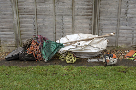 Winchester, Hampshire, England UK. A tree surgeons kit, Safety ropes, Plastic rakes for clearing up. Chain saw,