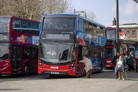 Salisbury, Wiltshire, England. March 2019, Buses on Blue Boar Row in Salisbury city centre. An elderly lady with walking frame boarding a double decker bus