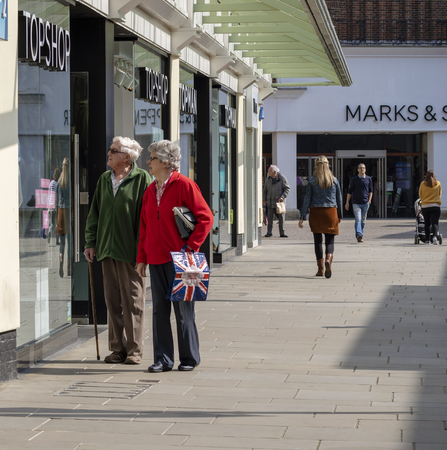 Salisbury, Wiltshire, England,UK March 2019. Couple window shopping in the city centre shopping precinct,