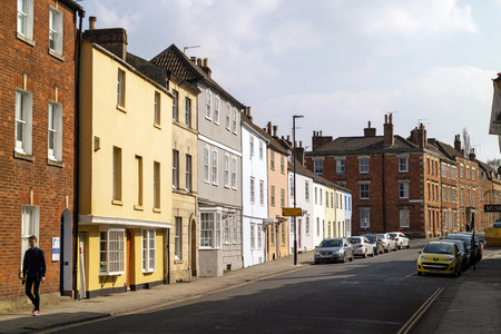 Devizes, Wiltshire, England, UK. March 2019. colourful houses on Long Street in the town centre.